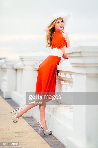 Young blonde woman enjoying summer