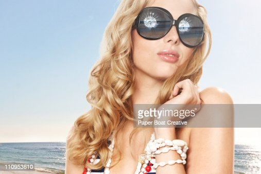 young blonde woman looking out at the horizon : ストックフォト
