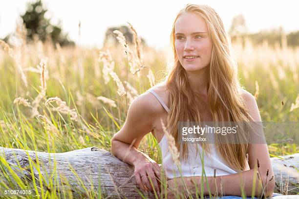 young blonde woman portrait on nature background