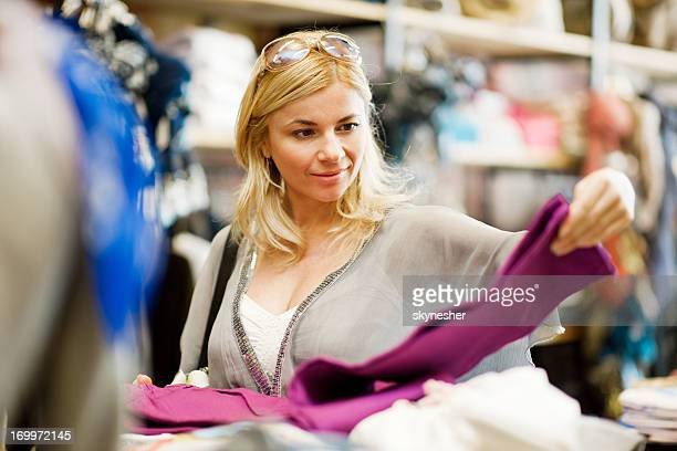 Young blonde woman shopping for clothes