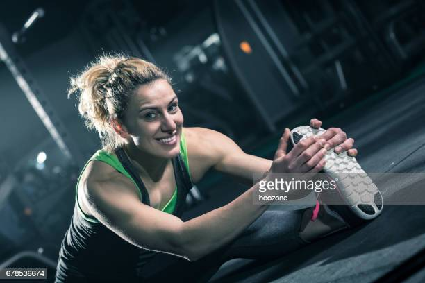 Young blonde woman stretching for better health