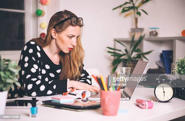 young blonde woman working in the creative office