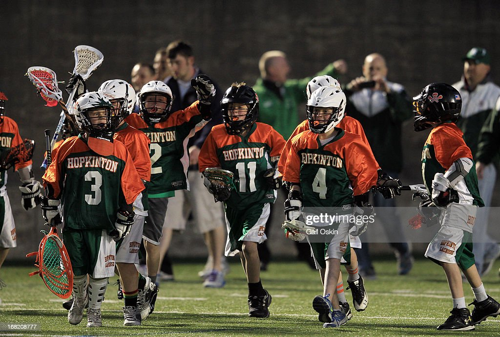 Young Boston Cannons fans run onto the field during halftime during a game between the Boston Cannons and the Hamilton Nationals May 4, 2013 in Boston, Massachusetts. The Hamilton Nationals defeated the Boston Cannons 15-8.