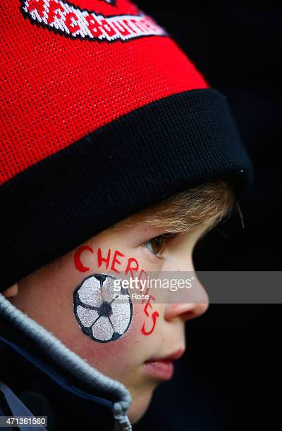 A young Bournemouth fan looks on prior to the Sky Bet Championship match between AFC Bournemouth and Bolton Wanderers at Goldsands Stadium on April...
