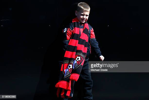A young Bournemouth supporter is seen prior to the Barclays Premier League match between AFC Bournemouth and Manchester City at Vitality Stadium on...