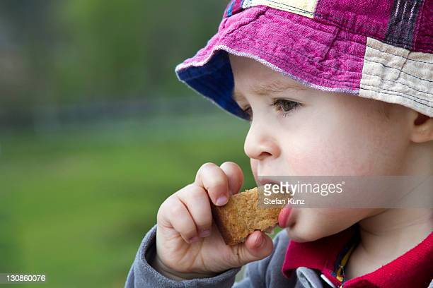 Young boy, 18 months, eating