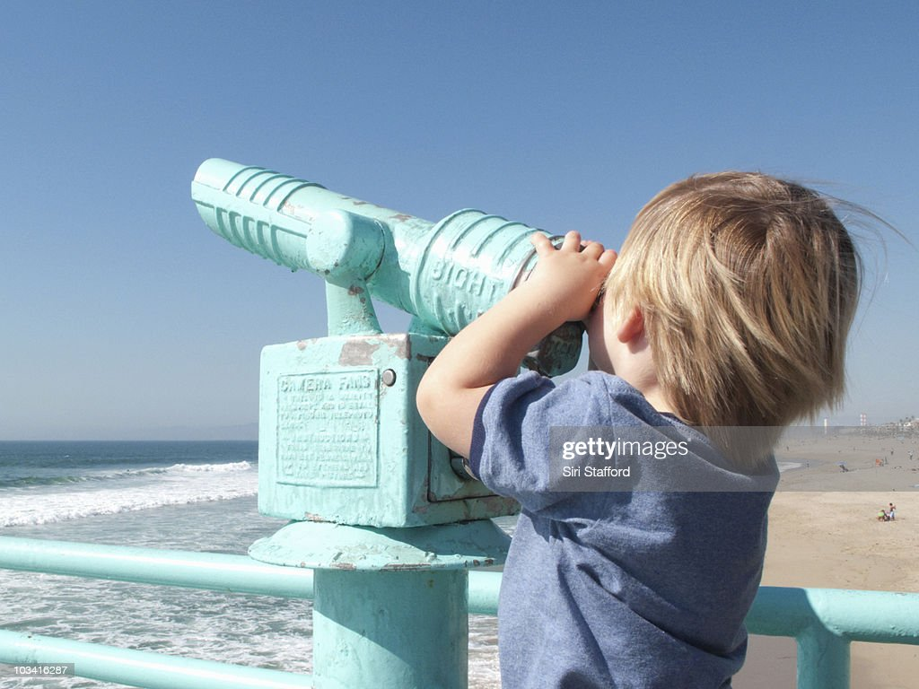 Young boy, 2 years old, looking through binoculars : Stock Photo