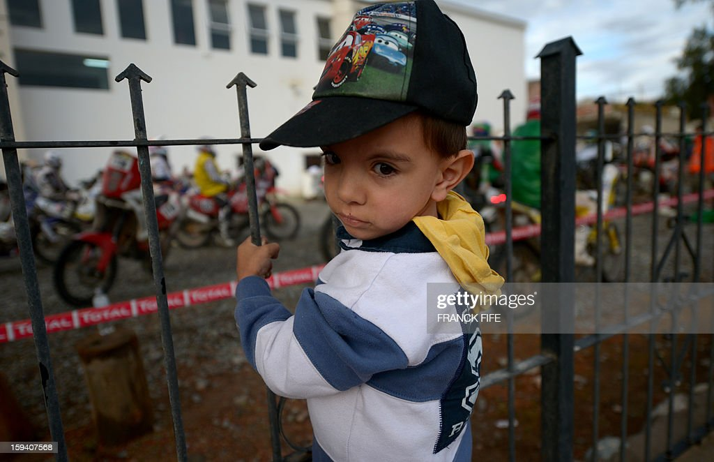 A young boy admires the parked motorcycles in Cachi after Stage 7 of the Dakar Rally 2013 between Calama and Salta, Argentina, on January 11, 2013. The rally takes place in Peru, Argentina and Chile January 5-20.