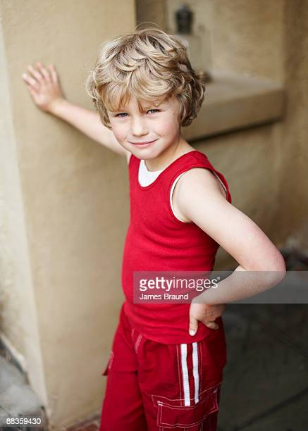 Young boy aged leaning against pillar