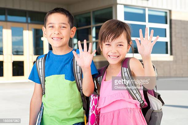 Young boy and girl at school