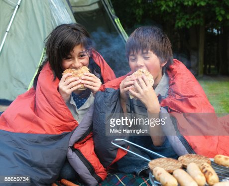 Young boy and girl camping  : Stock Photo