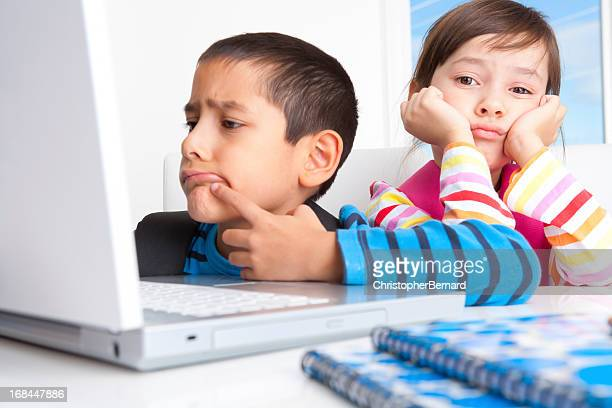 Young boy and girl researching on the internet
