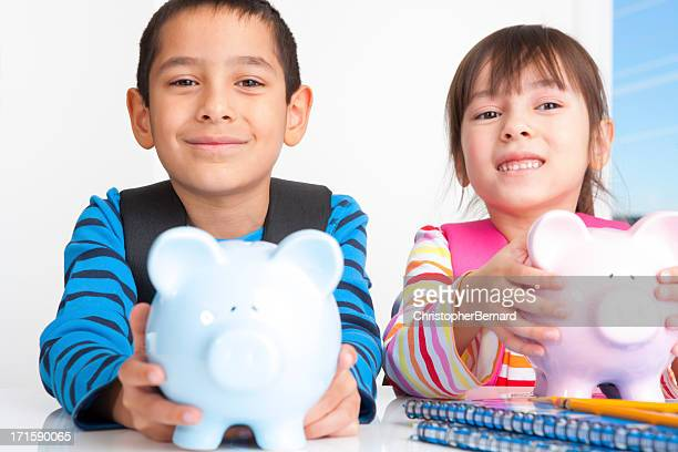 Young boy and girl saving money for school