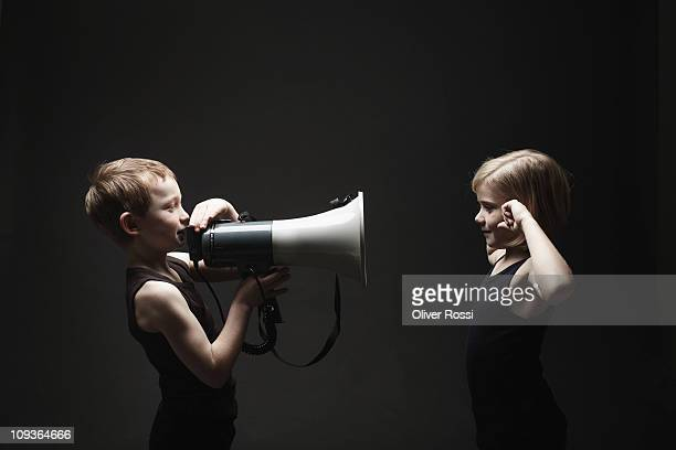Young boy and girl with megaphone