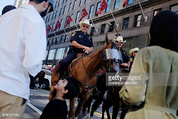 TOPSHOT A young boy and his family look at the horses of the Fort Worth Texas mounted police on the third day of the Republican National Convention...