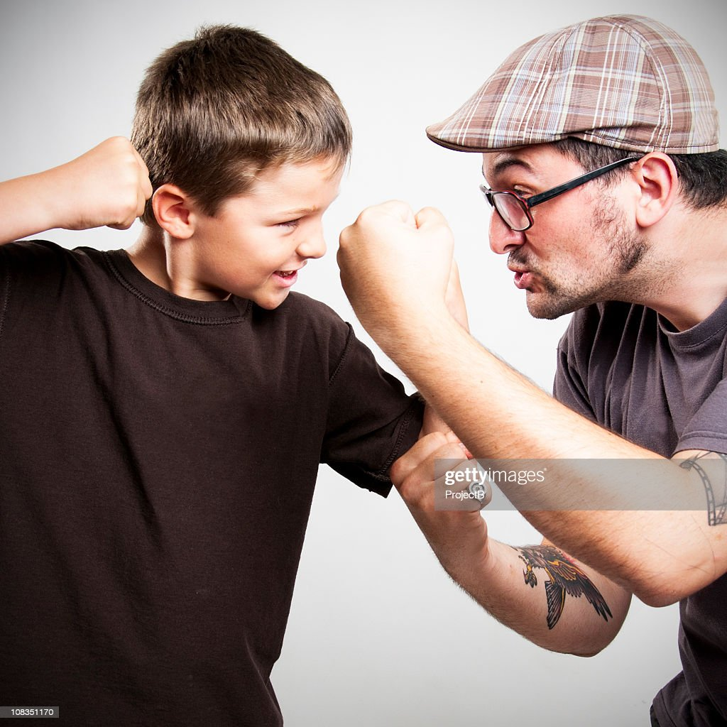 Young boy and man play fighting : Stock Photo