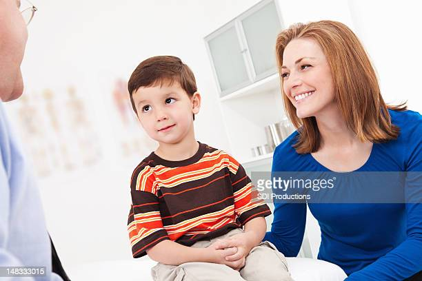 Young Boy and Mom in Doctor's Office.