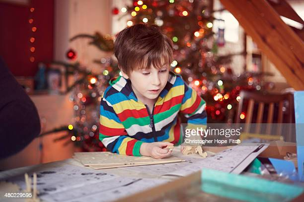 Young boy assembling wooden toy
