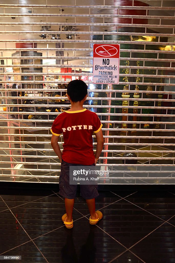 A young boy awaits the release of 'Harry Potter and The Cursed Child' at the Virgin Megastore in the Mall of the Emirates on July 31 2016 in Dubai