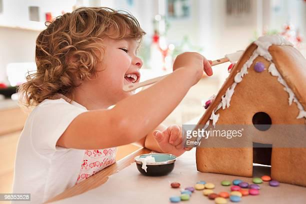 Young boy baking cake house