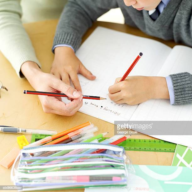 young boy being tutored by his teacher