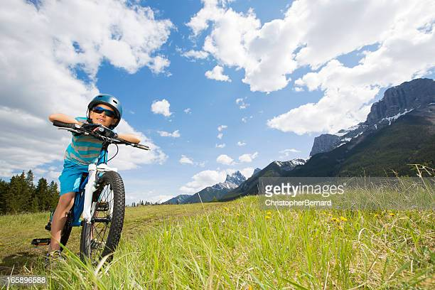 Young boy biking in beautiful scenary