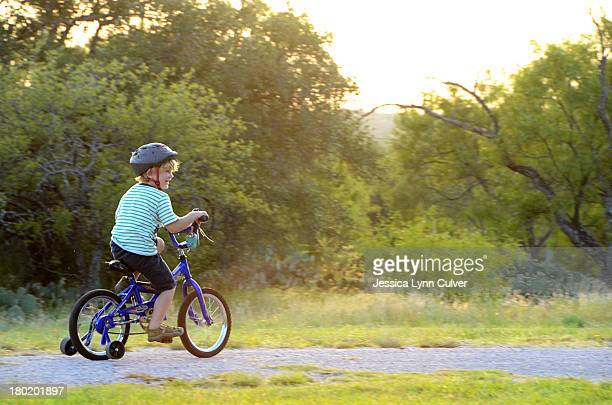 Young Boy Biking with Training Wheels