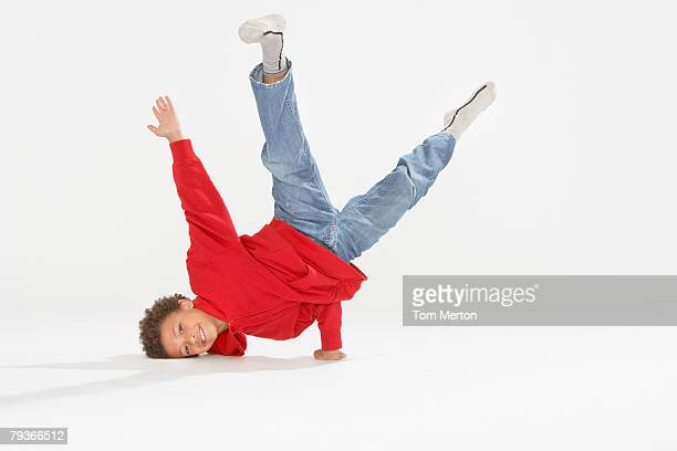 Young boy break dancing indoors