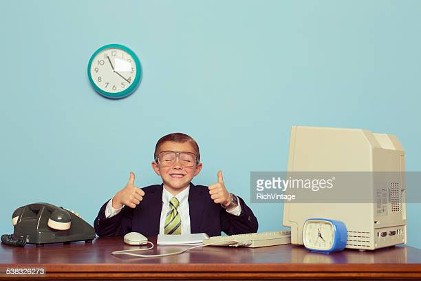 Young Boy Businessman Gives Thumbs Up at Office