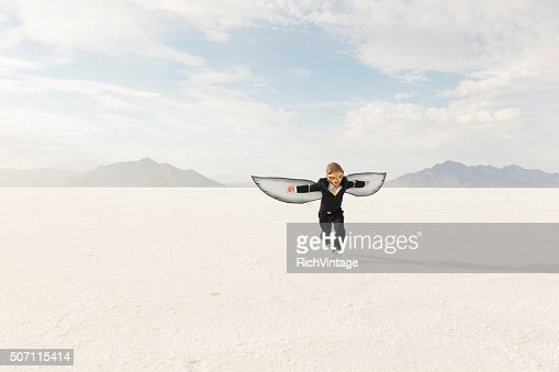 Young Boy Businessman is Flying Away