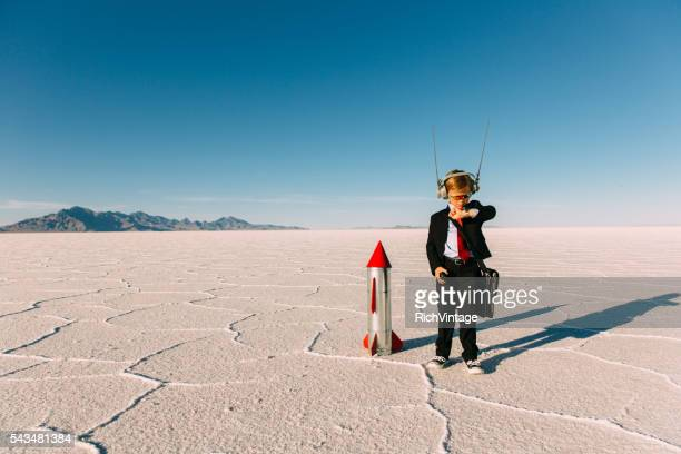 Young Boy Businessman Launching Rocket