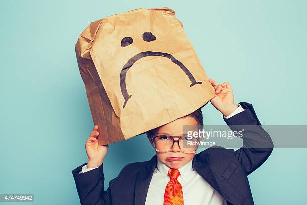 Young Boy Businessman Puts a Sad Face On