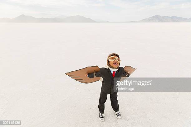 Young Boy Businessman Wearing Cardboard Wings