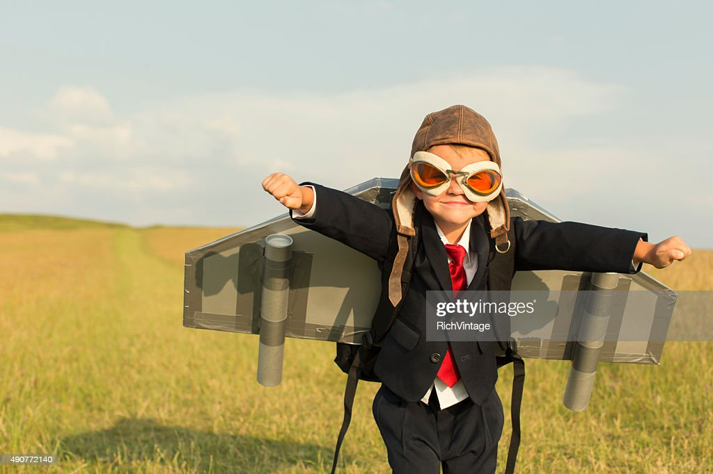 Young Boy Businessman Wearing Jetpack in England : Stock Photo