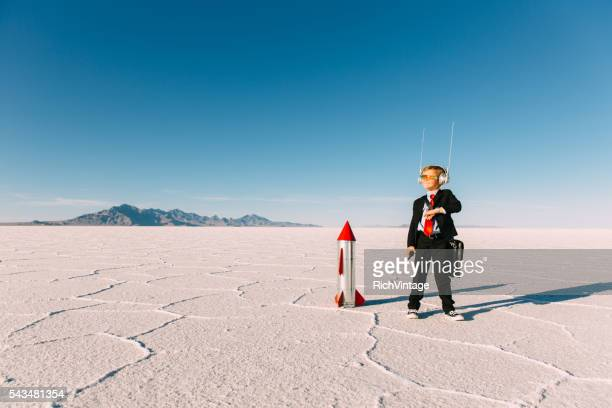 Young Boy Businessman With Rocket
