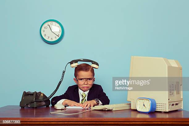 Young Boy Businessman with Telephone on His Head