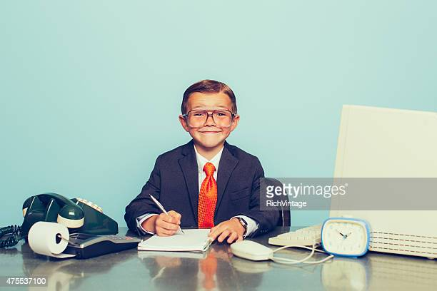 Young Boy Businessman Working at the Office