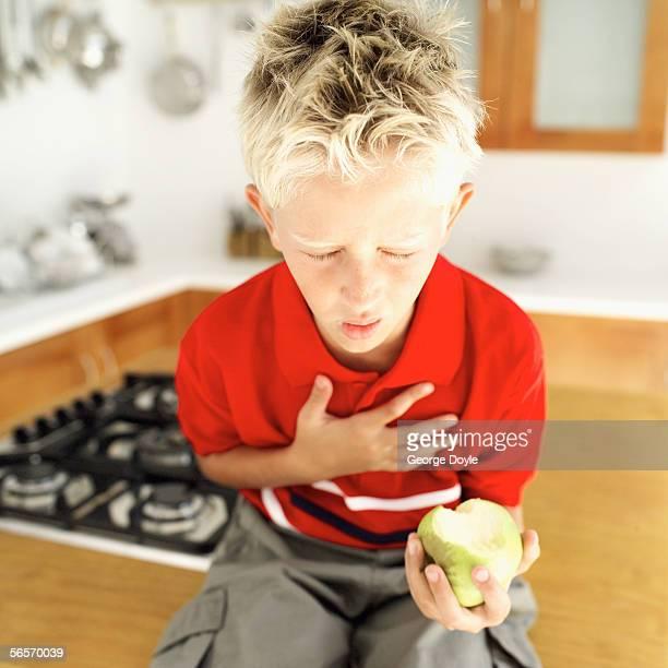 young boy choking