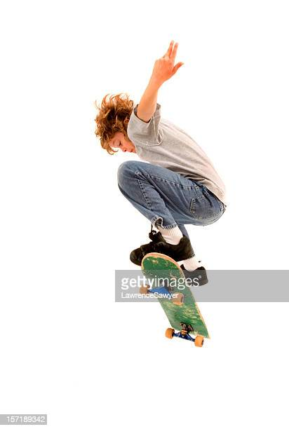 Young boy completing a skateboarding trick