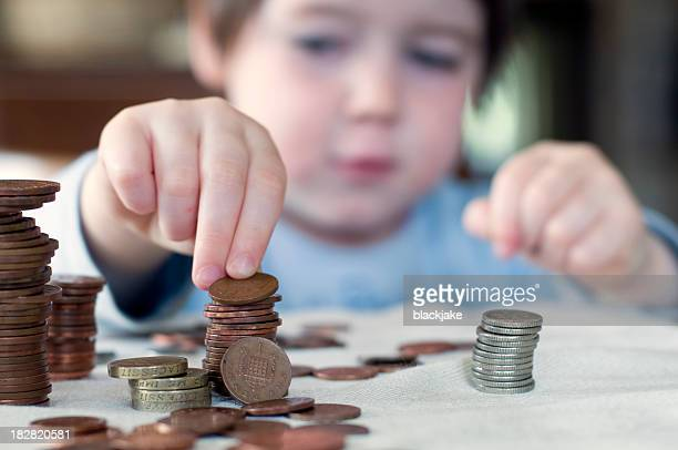 A young boy counting his piggy bank money