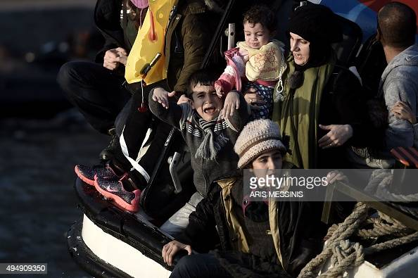 A young boy cries out for help with other refugees and migrants as their boat sinks off the Greek island of Lesbos after crossing the Aegean sea from...