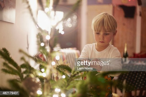 decorating with christmas boy decorating christmas tree stock photo getty images