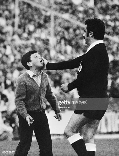 A young boy disputes a referee's decision during a soccer match between Malaga and Atletico Madrid Malaga Spain 3rd November 1972