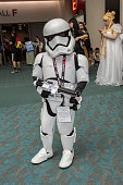 A young boy dressed as a Star Wars stormtrooper poses for photos at ComicCon International Day 3 on July 22 2016 in San Diego California