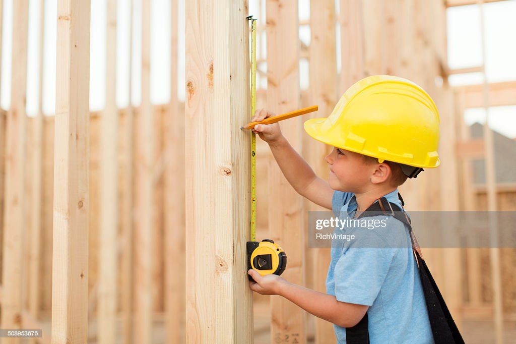 Young Boy dressed as Carpenter with Tape Measure : Stock Photo