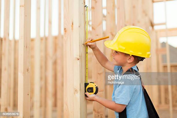 Young Boy dressed as Carpenter with Tape Measure
