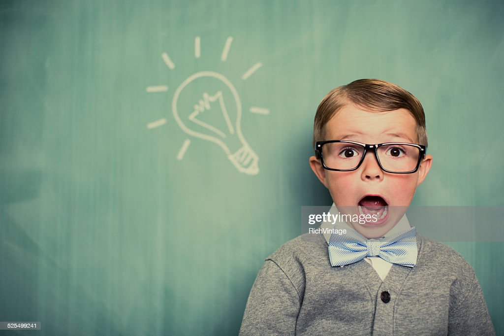 Young Boy Dressed as Nerd Has Big Idea : Stock Photo