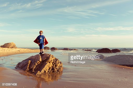 Young Boy dressed as Superhero on California Beach