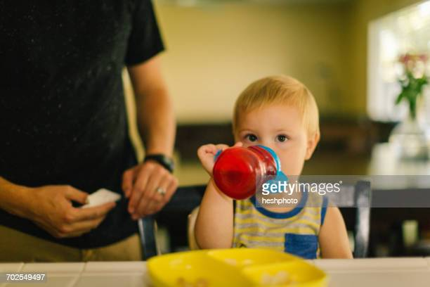 Young boy drinking from sippy cup
