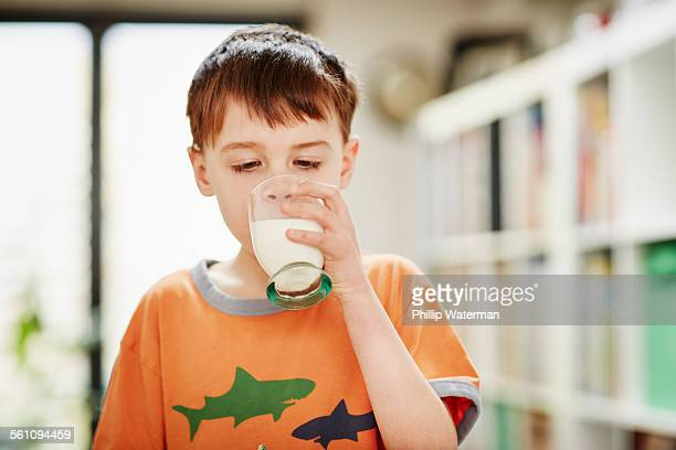 Young boy drinking glass of milk